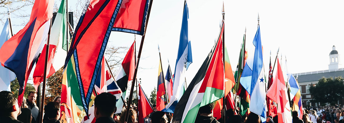 International Students hold their flags during the homecoming parade