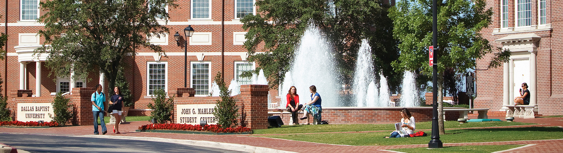 DBU Students on campus near Mahler Student Center and Blackaby Hall