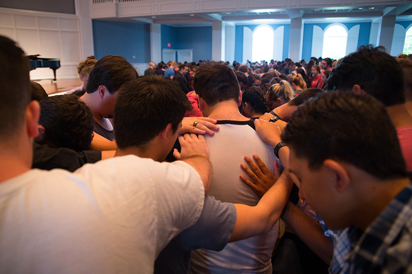 DBU students pray for fellow students impacted by Hurricane Harvey during Chapel on August 28, 2017.