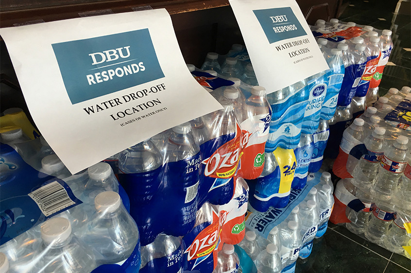 DBU is collecting whole cases of water to be delivered to the area through the efforts of Texas Baptist Men