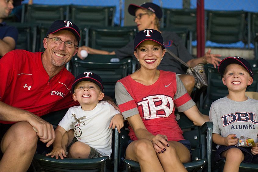 DBU Alumni Justin Gandy and Christy Brashier Gandy at the game with their two sons.