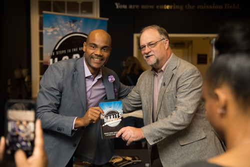 Dr. Goodloe and Dr. Mike Williams posing with a copy of Dr. Goodloe's HABITS book