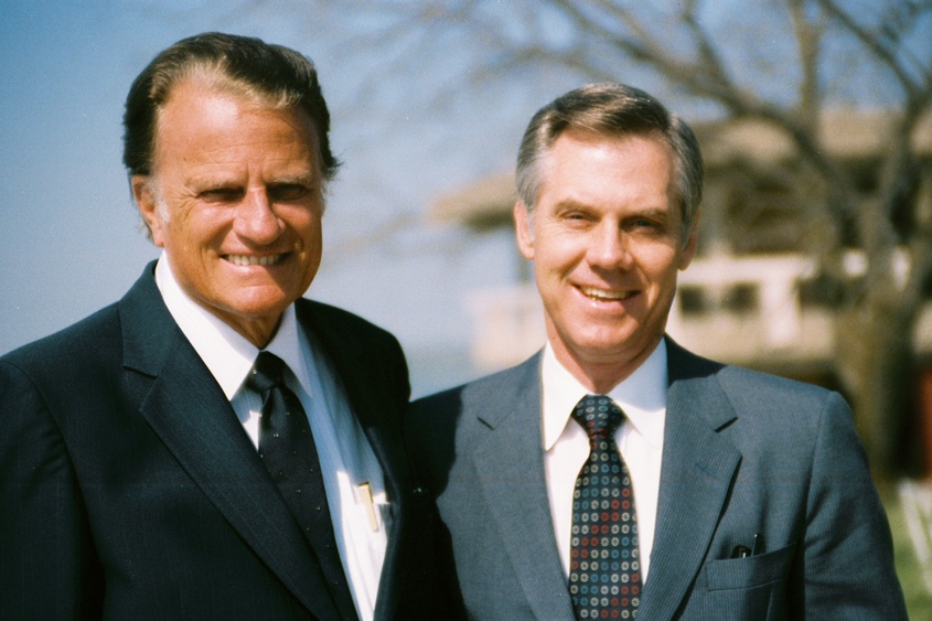 Dr. Billy Graham, along with then-pastor of Park Cities Baptist Church and former trustee, Dr. James Pleitz, at the commencement service held on the DBU campus in March of 1985.