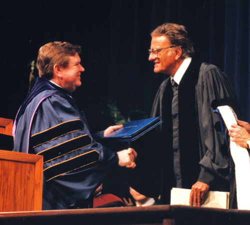 Dr. Billy Graham receiving an honorary degree from Dr. Marvin Watson